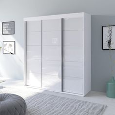 Aria 3 Door Wide Modern High Gloss Wardrobe ArmoireGlass fronts with matte bodyManufactured in and imported from the European UnionModern and unique contemporary designPerfect for those in need of living room storage spaceFlat packed and. White Closet, White Wardrobe, Wardrobe Closet, Closet Bedroom, Walk In Closet, Living Room Storage, Bedroom Storage, Storage Spaces, Wardrobe Cabinets