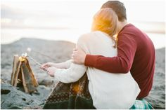 roast marshmallows together  Lora Grady // seattle beach campfire engagement photographer