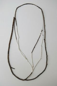 How about this necklace on the white dress I just pinned? (http://pinterest.com/pin/117093659034723474/)  Lovely...