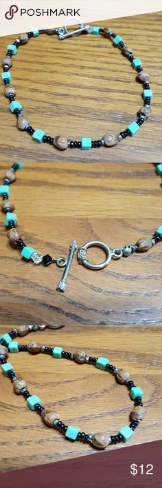 Ankle bracelet TURQUOISE This ankle bracelet is in 925 silver? Turquoise beads as well as olive seeds that came from the Holy Land in Jerusalem.  Accented with small black beads.   I brought these back years ago & dried them myself.  I only had 11 beads that was usable so I made a ankle bracelet.   Feel free to ask any questions before purchasing.   Thank you for shopping my closet! Jewelry Bracelets