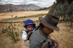 One-year-old Luis and his mother, Maria Broncano Mejia, are indigenous Quechua who live in the Andean community of Llacuash. Indigenous children continue to face unequal access to basic services. UNICEF is working with the Government to ensure that more indigenous children are legally registered as citizens, enabling them to enrol in school and access national health services.    Peru, 2011 ©UNICEF/LeMoyne