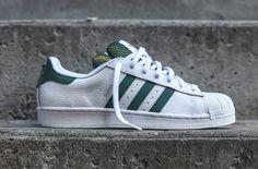http://SneakersCartel.com A White Tumbled Leather Upper And Green Accents Combine On The adidas Superstar #sneakers #shoes #kicks #jordan #lebron #nba #nike #adidas #reebok #airjordan #sneakerhead #fashion #sneakerscartel