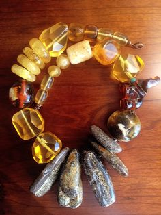 An unusual variety of colours and shapes are found in this Baltic amber necklace. Chunky Jewelry, Amber Jewelry, Gemstone Jewelry, Bold Necklace, Diy Necklace, Unusual Jewelry, Simple Jewelry, Coral, Baltic Amber Necklace