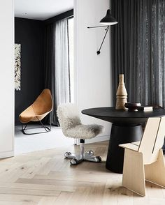 rosegoldenfilesHome in district of Melbourne filled with sculptural furniture: Clerici chair, Asplund Tati coffee table, Carl Hansen & Sons CH888 chair, Gubi's black marble table, and Mantis BS2 wall lamp | : @amerrymishap