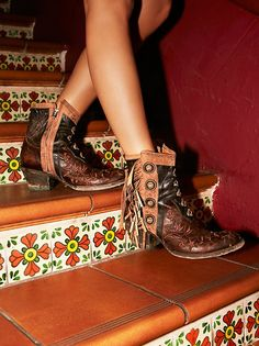 King Ranch Ankle Boot   Western-inspired ankle boots featuring beautiful embroidery detailing with metal accents and statement fringe trim. Round toe and a stacked heel. Inside zipper closure for an easy on/off.