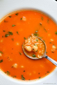 A quick and filling soup with rice and chickepeas in a flavorful tomato broth.