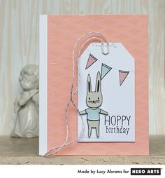 Hoppy Birthday by Lucy Abrams for Hero Arts. Create a fun and shiny background with a stencil and embossing paste.