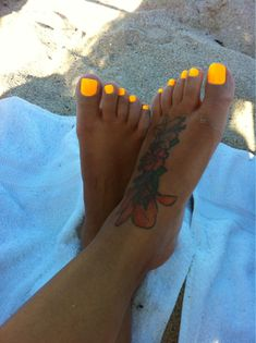 I love this color. Sun Worshiper by China Glaze. Looks like she has a coat of white underneath to make the color pop...?