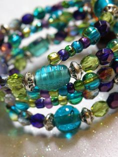 Mermaid Memory Wire Bracelet project on Craftsy.com.... These colours!!