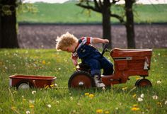 Little Boy Pulling Wagon with Pedal Tractor
