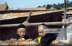 Two young Chinese actors leaning against a fence in the film The last emperor 1987 Bernardo Bertolucci, Last Emperor, Movie Photo, Filmmaking, Fence, Cinema, Actors, Movies, Emperor