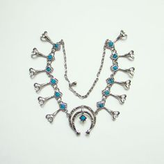 Vintage Faux Turquoise Silvertone Naja Squash Blossom Necklace by redroselady on Etsy