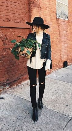 belted leather jacket. skinny jeans. knit top. #streetstyle