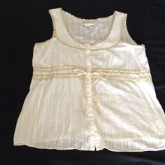 """Lightweight white tank top with lace Really cute lace trim and laced through ribbon that ties at the waist into a bow, will fit up to 40"""" bust, length is 27"""", this is a maternity top that I wore when I was not pregnant because I think it's cute Old Navy Tops Tank Tops"""
