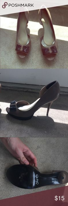 """Dark beige heels with black glitter bows Worn only once or twice, 4"""" heel 1"""" platform at toe, have sole pads and heel protectors inside. Shoes Heels"""
