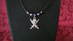 Silver Skull and Swords Pendant with Blue Beads by PirateKatsBooty, $25.00