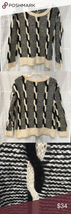 Sparkle & Fade black & cream cable knit sweater Sparkle & Fade black and cream cable knit pullover sweater. VGUC, very slight showing of wear to fabric. No other damage. I'm open to reasonable offers and give bundle discounts! ☮️✌️ Sparkle & Fade Sweaters Crew & Scoop Necks