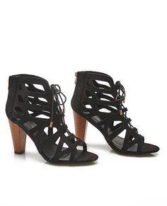 """<p>These heels features a faux suede upper with a laser cut design, a lace-up front, and an open toe.</p>  <ul> <li>4"""" Shaft</li> <li>4"""" Heel</li> <li>Zip Closure</li> <li>Lightly Padded Footbed</li> <li>Textured Sole</li> <li>Man Made Materials</li> <li>Imported</li> </ul>"""