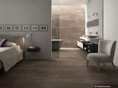 Wood-like tile? I think it will make the condo feel bigger with one type of flooring throughout.