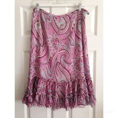 """Paisley Skirt New York & Company pretty pink paisley skirt, size 10. Side hook & zipper closure, fully lined. 100% polyester. 26.75"""" in length (hits above the calf on me, I'm 5'8""""), waist measures 16.5"""". Worn once. New York & Company Skirts Midi"""