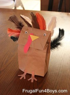 Paper Bag Turkey Puppets - stuff them with tissue paper and they stand up on their own.  Great decoration for the table!