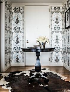 Janet Rice Interiors - Glamorous foyer with black & blue DG medallion wallpaper,