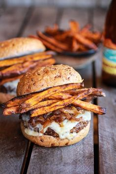 Epic Crispy Quinoa Burgers Topped with Sweet Potato Fries, Beer Caramelized Onions and Gruyere