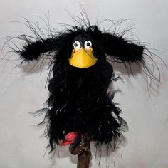 Crow puppet. Wings are hinged
