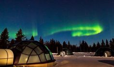An Igloo Resort in Finland with glass tops so people can view the Auroras,