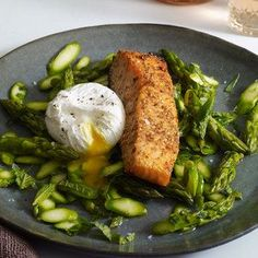 Coriander-&-Lemon-Crusted Salmon with Asparagus Salad & Poached Egg | Crushed coriander seeds and lemon zest give this quick salmon recipe praiseworthy flavor that pairs beautifully with a shaved asparagus and poached egg salad.