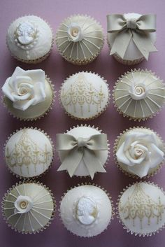 white fondant cupcakes with rose, bow and chandelier detail