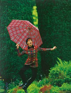 Love this equestrienne style - a great mixture of red plaid.  I have got to have that umbrella!