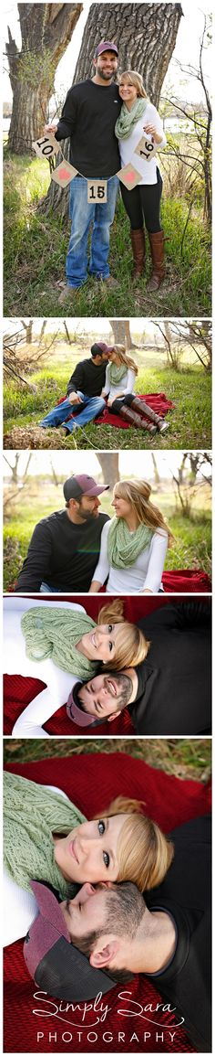 Outdoor Engagement Photo Ideas & Poses in the Spring - Save the Date Sign - Sitting on a Red Blanket in a Field - Billings, MT Engagement & Wedding Photographer