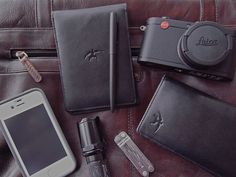 Daily Carry Tusked Crescent Pocketbook & Long Wallet with Fisher Capomatic pen, Leica X2, Leatheman Micra, iPhone & Surefire Defender flashlight