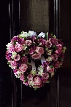 Heart-Shaped Rose Wreath ~ This looks like it is made with real flowers, but you could always use silk flowers.