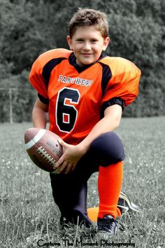 Sports photography. Football portrait. Black and white with color accents. Capture the Moment Photography