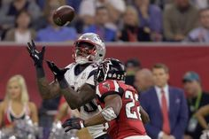 New England Patriots tight end Martellus Bennett eyes the ball under pressure from Atlanta Falcons defender Keanu Neal during the second half of Super Bowl LI on Sunday, Feb. 5, 2017, at NRG Stadium in Houston.