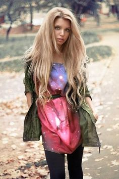 Blue and pink galaxy dress with an olive green anorak (jacket).