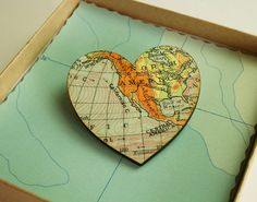 A vintage map decoupaged onto a heart-shaped brooch - Choose your own map location or allow us to choose for youIt's secured in place with a pin back, safety catch. Each brooch is also presented in it's own individual gift box. <strong>Choosing your own map location? </strong>We have more than 15,000 vintage maps in our collection so we're bound to have the one you're after. And if on the rare occasion we don't already have it, we'll do our best to source it for you. <strong>Important: ...