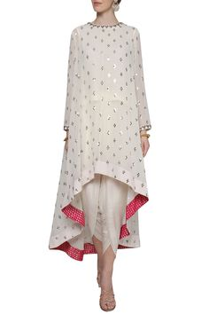 Vvani by Vani Vats Featuring an off white asymmetrical kurta in georgette base embellished with sequin hand embroidery and brocade inline borders. It is paired with dhoti pants in crepe base.Costumised similar dress for order HOUSE OF ZUHAF Pakistani Dress Design, Pakistani Outfits, Indian Outfits, Designer Party Wear Dresses, Kurti Designs Party Wear, Dress Indian Style, Indian Dresses, Indian Wear, Moda Indiana