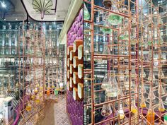 Rather than opting for a simple presentation of products, the studio designed and built twin lattices made from copper piping – 120 m in total – that hold more than 150 glass flasks, each containing one of the raw ingredients that go into the 32 fragrances available at Penhaligon's.