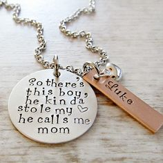 "This hand stamped personalized Mothers necklace will be stamped on a 1"" sterling silver disc with the saying ""So there's this boy....he kinda stole my <3....he calls me Mom"".  The antique copper tag(s) will be personalized with your sons' name.   FIRST NAMES ONLY PLEASE.Silver filled puffy heart charm accents.20"" stainless steel chain is included.PLEASE READ BEFORE ORDERING IF ORDERING MORE THAN ONE NECKLACE:  The number of copper name tags will be the TOTAL number..."