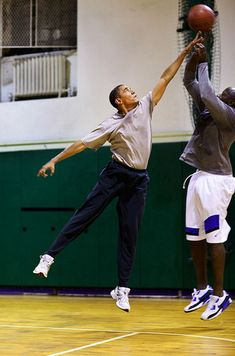 President Obama trying to block a shot during a basketball game: