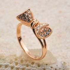 14K rose gold bow ring with white topaz accents