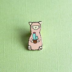 This cactus alpaca enamel pin is based on my original felted alpaca holding a cactus design. Add it to your tote bag, jacket or pin collection and take your alpaca companion with you everywhere you go. Cute Patches, Pin And Patches, Alpaca Gifts, Cactus Gifts, Hard Enamel Pin, Cool Pins, Metal Pins, Needle Felted Animals, Kawaii