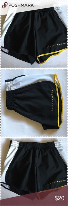 """Nike Dri Fit Livestrong Wht/Yellow/Blk Shorts Sm In Excellent Condition Nike Dri Fit Livestrong Wht/Yellow/Blk Athletic Shorts Sm built in liner, a small folded pocket, white sides, livestrong label in Yellow at right hip, elastic waist with drawstring. measurements are as follow: Waist: 13"""" Length: 10"""" Inseam: 4 Hips: 9"""" Feel free to browse my closet and if you have any questions!! All offers are welcomed! Nike Shorts"""