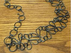 wire jig necklace by The Bench Artisans - from FingerDoodling with Brenda Schweder: Make Perfectly Matched Multiples for Easy Wire Jewelry Making - Jewelry Making Daily