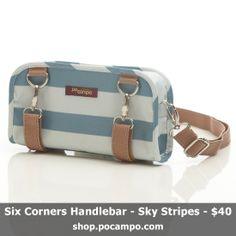Six Corners Handlebar Bag converts to a cute crossbody bag when off the bike. Weatherproof, vegan fabric. Shown in blue Sky Stripes color.