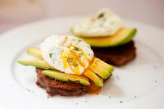 cilantro and lime poached eggs with avocado and blue potato cakes