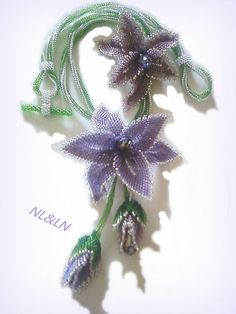 """Necklace """"IRENE""""Beautiful flower arrangement, consisting of two orchids peeled and two closed budscolor of the flowers lavender and frosted sugar plum, silver edgingchain made of technical Ndebele in green peridot and silverLong-55cmflowers-8x8cm"""